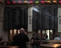El Ibex sube un 0,35% en la apertura con la prima de riesgo a la baja, en 404 puntos