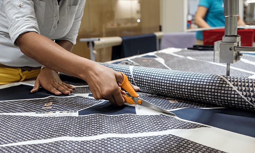 Hermés firma textil